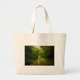 Hiking trail through the woods large tote bag