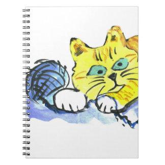 Hilado… ¿Qué hilado? pide Tig - gatito anaranjado Libretas