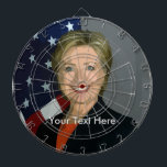 "Hillary Clinton Custom Metal Cage Dartboard<br><div class=""desc"">The design features Democratic Presidential Candidate Hillary Clinton.  She&#39;s often a prime target and whether you love her or hate her this will be an interesting conversation piece.</div>"