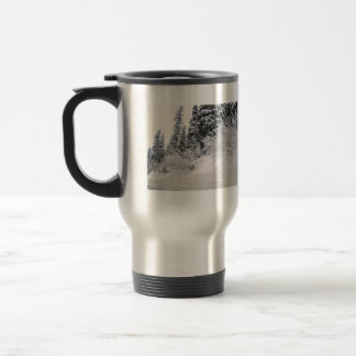 Hillside with pine trees covered with snow 15 oz stainless steel travel mug