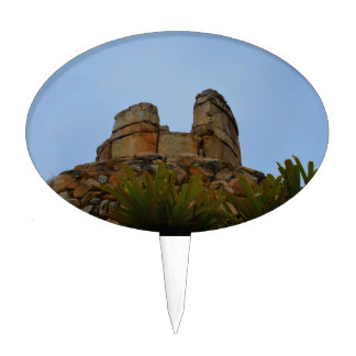 hilltop stacked stones against sky cake topper