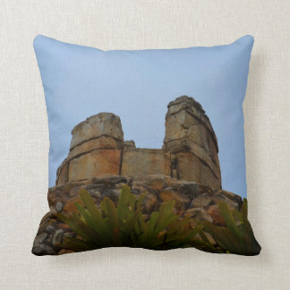 hilltop stacked stones against sky pillow