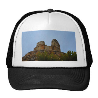 hilltop stacked stones against sky trucker hat