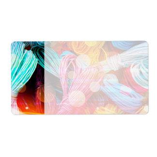 Hilos coloridos intrépidos del hilado y haces lumi etiqueta de envío