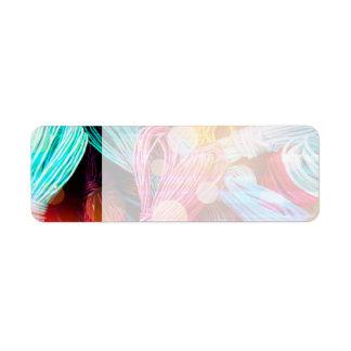 Hilos coloridos intrépidos del hilado y haces lumi etiqueta de remite