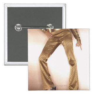 Hip woman in gold disco dancing button