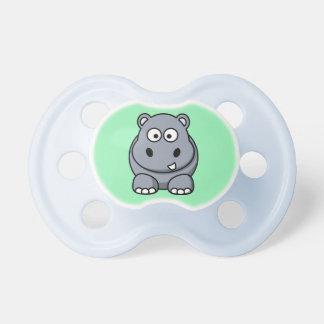Hipopótamo en un fondo de la menta chupetes de bebe