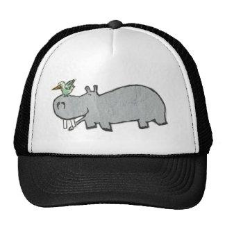 Hipopótamo que cuelga hacia fuera con su amigo del gorros