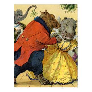 Hipopótamo y oso en la bola del navidad en la tier tarjeta postal