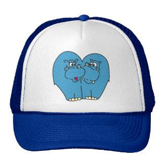 Hipopótamos lindos del dibujo animado en gorra del