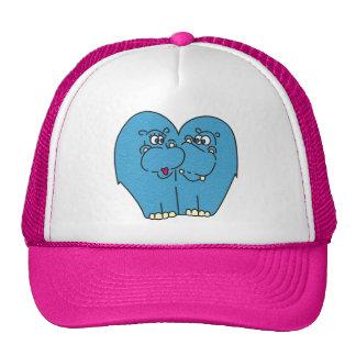Hipopótamos rosados del dibujo animado en gorra