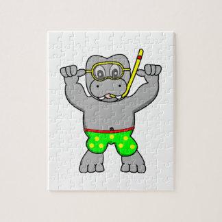 Hippopotamus del dibujo animado que bucea en bañad puzzles