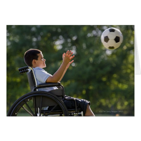 Hispanic boy, 8, in wheelchair with soccer ball card