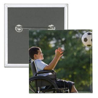 Hispanic boy, 8, in wheelchair with soccer ball pinback button