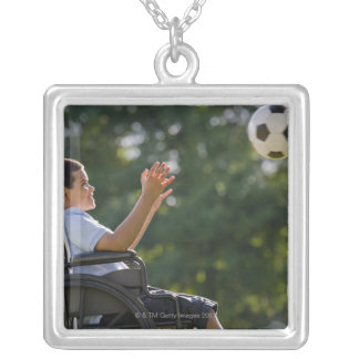 Hispanic boy, 8, in wheelchair with soccer ball square pendant necklace