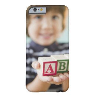 Hispanic boy holding alphabet blocks barely there iPhone 6 case