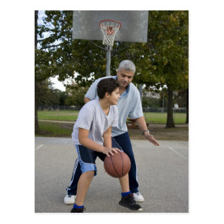 Hispanic father and son playing basketball postcard