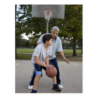 Hispanic father and son playing basketball postcard