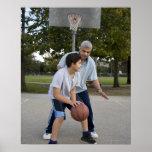 Hispanic father and son playing basketball poster