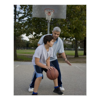 Hispanic father and son playing basketball poster