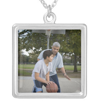 Hispanic father and son playing basketball square pendant necklace