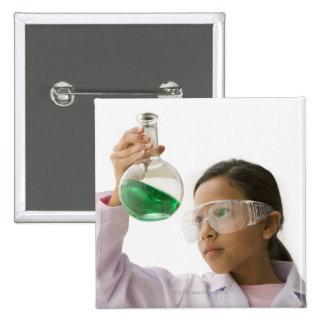 Hispanic girl looking at liquid in beaker pinback button