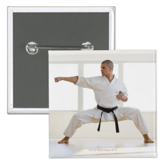 Hispanic male karate black belt in fighting 2 inch square button