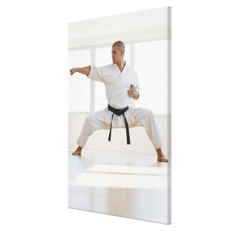 Hispanic male karate black belt in fighting canvas print