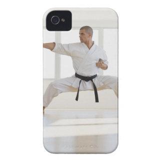 Hispanic male karate black belt in fighting iPhone 4 case
