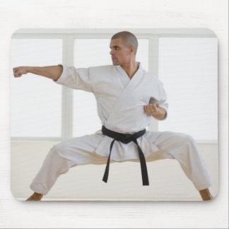 Hispanic male karate black belt in fighting mouse pad