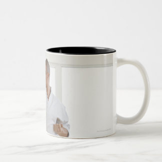 Hispanic male karate black belt in fighting Two-Tone coffee mug