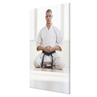 Hispanic male karate black belt meditating canvas print