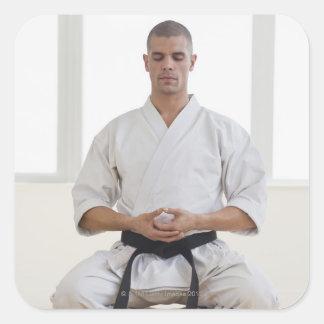 Hispanic male karate black belt meditating sticker