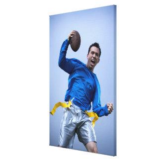 Hispanic man throwing a football canvas print