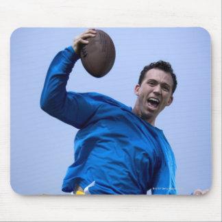 Hispanic man throwing a football mouse pad