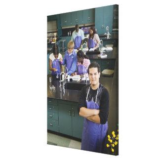 Hispanic student standing in chemistry lab canvas prints