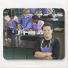 Hispanic student standing in chemistry lab mouse pad