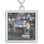 Hispanic student standing in chemistry lab square pendant necklace