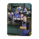 Hispanic student standing in chemistry lab rectangular photo magnet