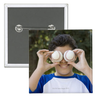 Hispanic teenage boy covering eyes with pin