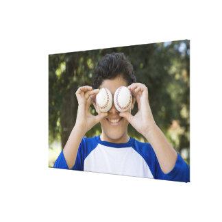 Hispanic teenage boy covering eyes with canvas print