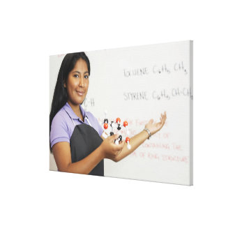 Hispanic teenaged girl in science class canvas print