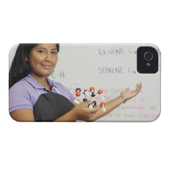 Hispanic teenaged girl in science class iPhone 4 cover