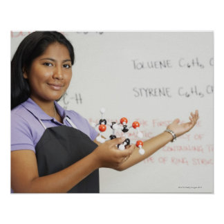 Hispanic teenaged girl in science class poster