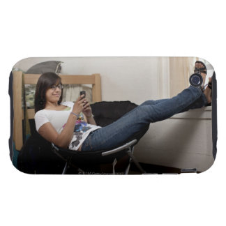 Hispanic woman hanging out in college dorm room tough iPhone 3 case