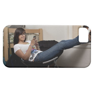 Hispanic woman hanging out in college dorm room iPhone 5 cover