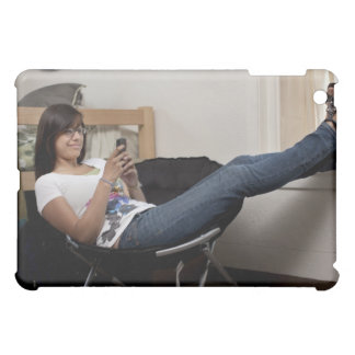 Hispanic woman hanging out in college dorm room iPad mini case