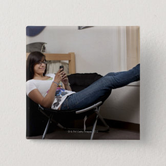 Hispanic woman hanging out in college dorm room pinback button