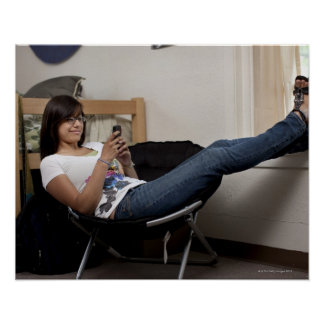 Hispanic woman hanging out in college dorm room poster