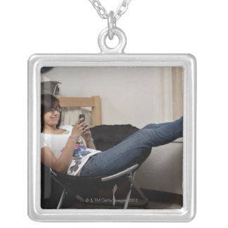 Hispanic woman hanging out in college dorm room silver plated necklace